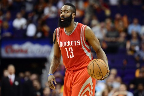 Feb 10, 2015; Phoenix, AZ, USA; Houston Rockets guard James Harden (13) dribbles against the Phoenix Suns at US Airways Center. The Rockets won 127-118. Mandatory Credit: Joe Camporeale-USA TODAY Sports