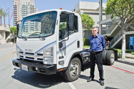 Wrightspeed founder and CEO Ian Wright with a CNG-fueled boosted electric truck at Act Expo 2012 in Long Beach, Calif. Mel Lindstrom photo