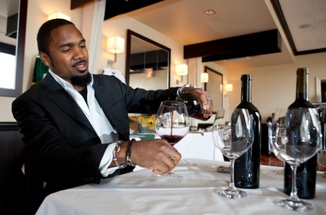 schacol01, fea, lynn, 3.-Green Bay Packer and winery owner Charles Woodson with a few bottles of his wine talks about how he became interested in wine Thursday April 14, 2011 at Bacchus-A Bartolotta Restaurant. Photo by Tom Lynn/TLYNN@JOURNALSENTINEL.COM