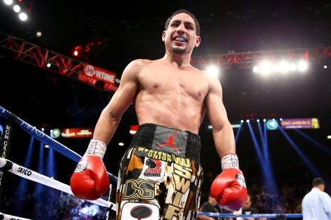 (L-R) Danny Garcia throws a right to the body of Lucas Matthysse during their WBC/WBA super lightweight title fight at the MGM Grand Garden Arena on September 14, 2013 in Las Vegas, Nevada.