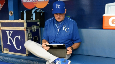 royals-coach-rusty-kuntz-uses-an-ipad-prior-to-game-3-of-last-years-american-league-championship-series.-100653327-large